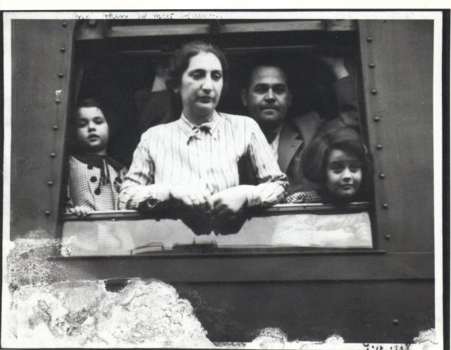 A close up photograph of the family on the train.