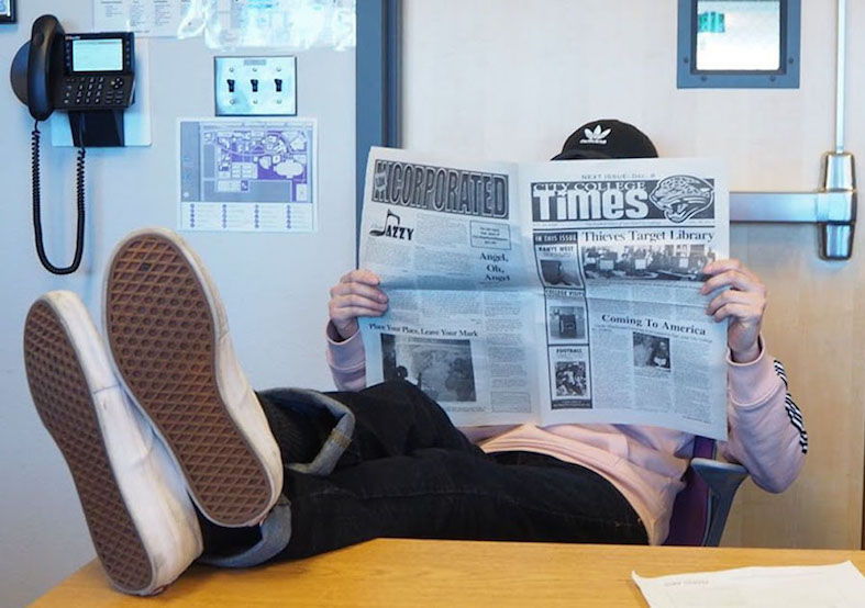 City College Times Editor-in-Chief of spring 2020 Jasper Somera relaxes in the newsroom with a copy of the City College Times newspaper.