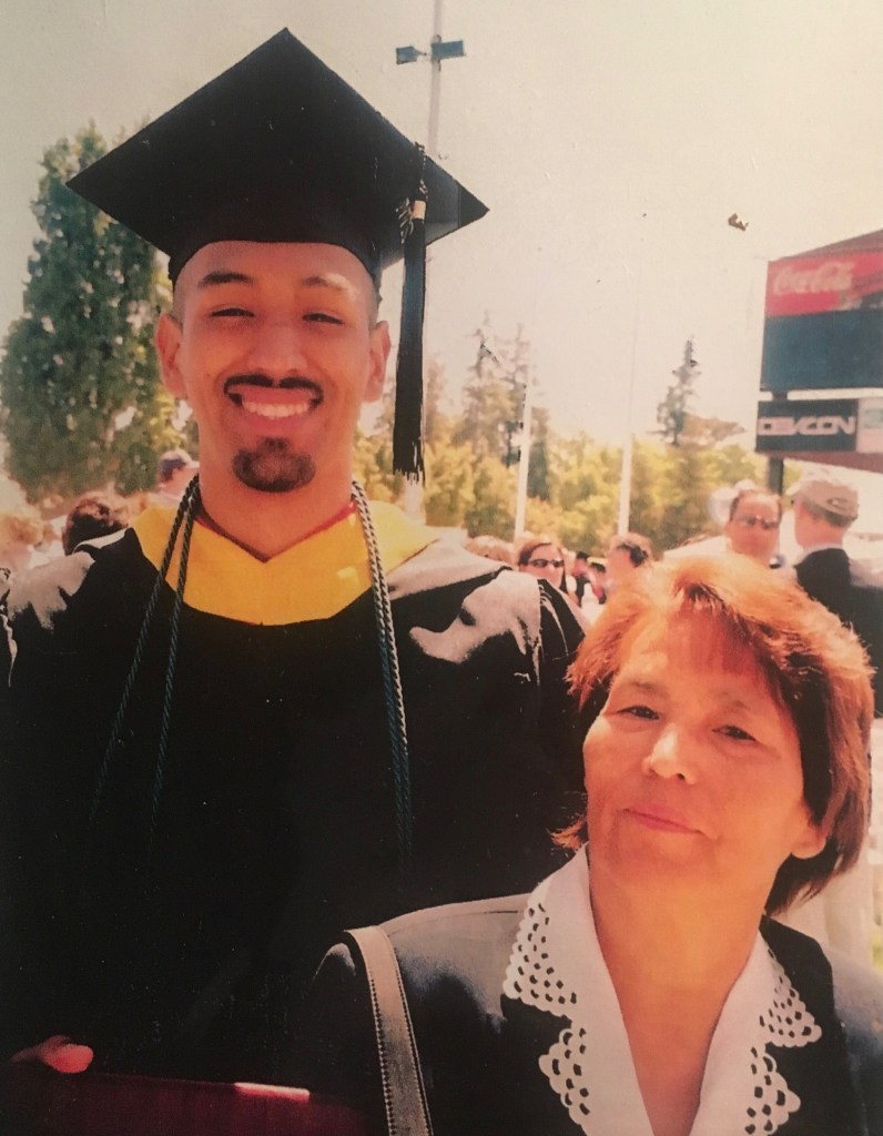 Jorge Arellano in his cap and gown with his mother during his graduation from San José City College
