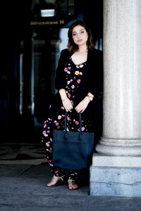 black blazer paired with black jumpsuit with floral print