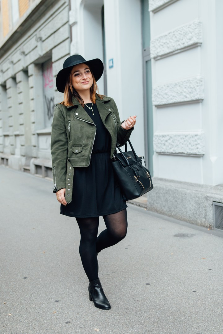 Walking with LBD paired with boots and hat
