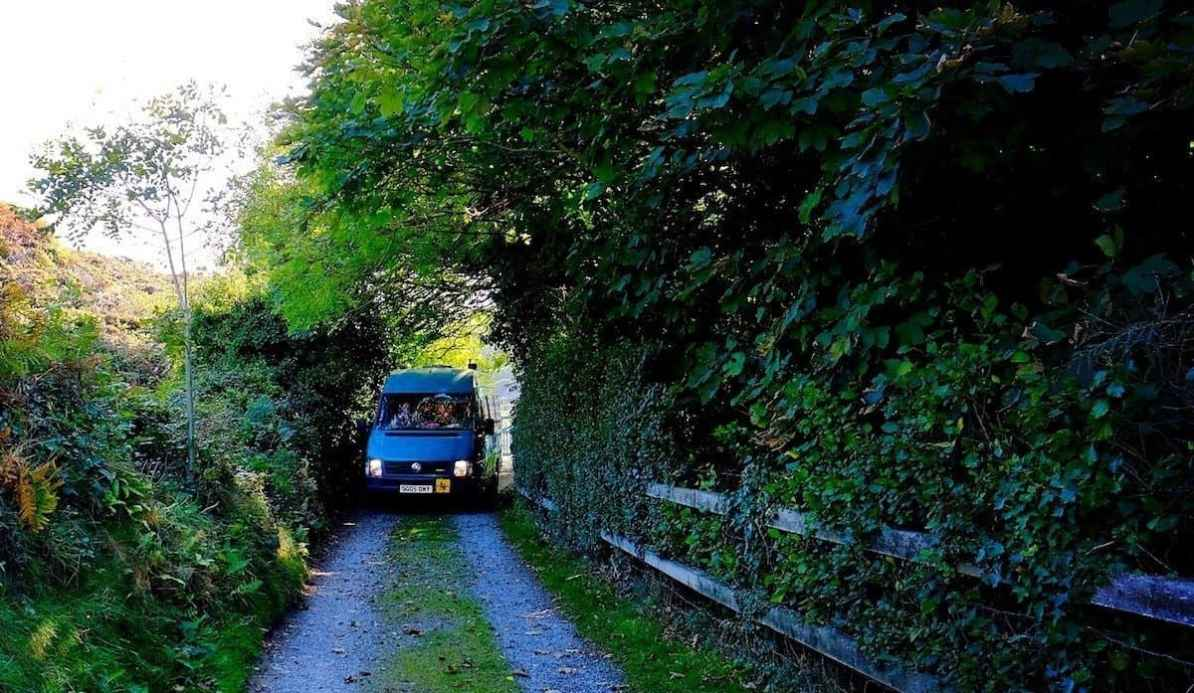 campervan on small road, camping in october