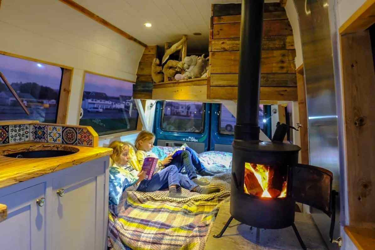 woodburner inside campervan, camping in october