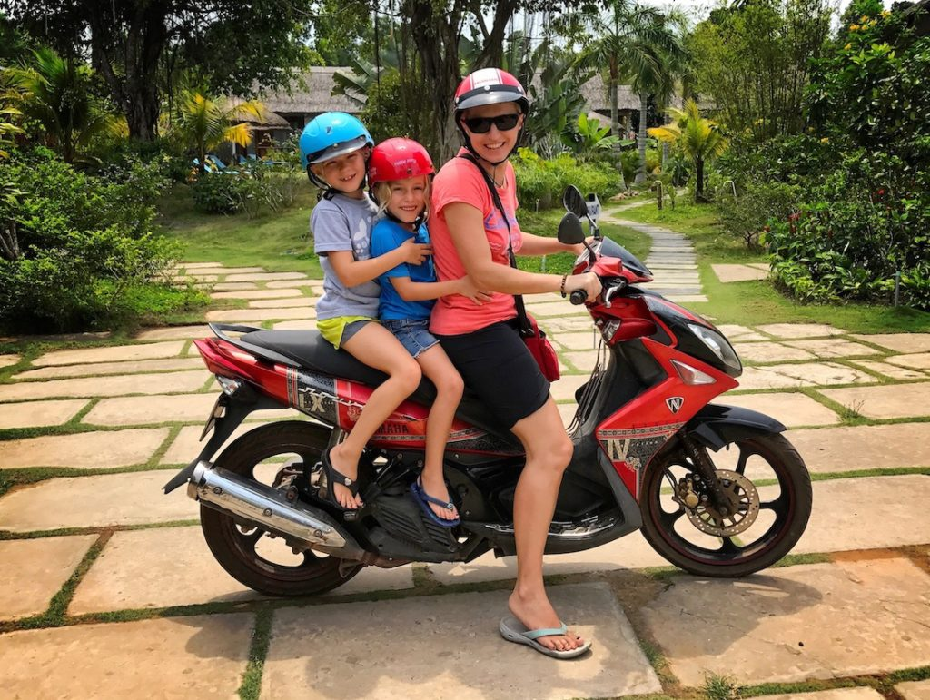 what to do with kids in Phu Quoc Island - mummy and her daughter on the scooter