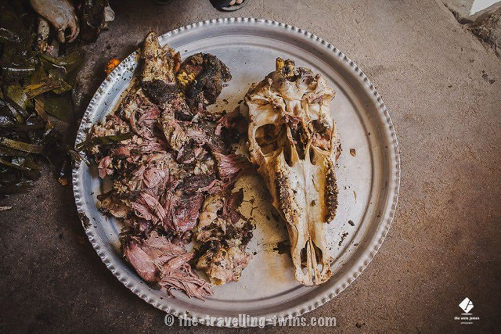 Oman food - shuwa - ox skull peel from meat