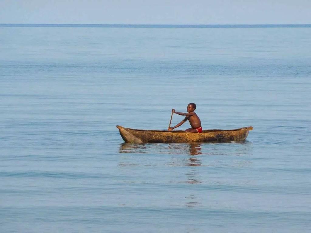 boy in a canoe on lake Malawi