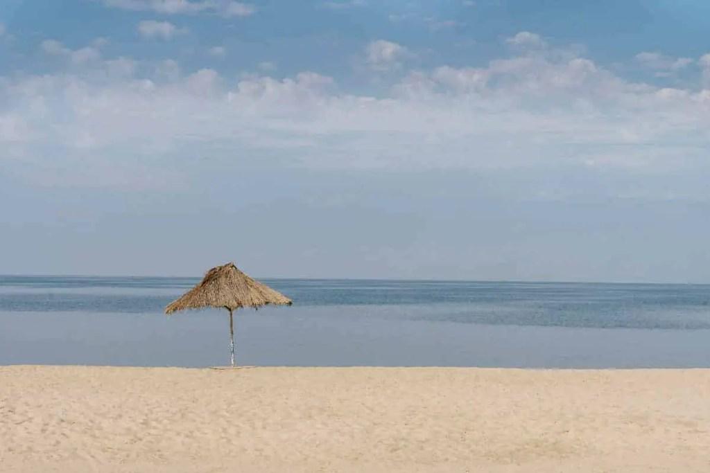 beach and umbrella on the shore of Lake Tanganyika