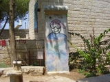 """<h5>Thanks Avishai Teicher</h5><p>© <a href=https://commons.wikimedia.org/wiki/File:PikiWiki_Israel_13687_Section_of_the_Berlin_Wall_in_Ein_Hod.jpg#/media/File:PikiWiki_Israel_13687_Section_of_the_Berlin_Wall_in_Ein_Hod.jpg"""" target=""""_blank"""" >PikiWiki Israel 13687 Section of the Berlin Wall in Ein Hod</a>"""" by צילום:ד""""ר אבישי טייכר. Licensed under <a title=""""Creative Commons Attribution 2.5"""" href=""""http://creativecommons.org/licenses/by/2.5"""" target=""""_blank"""" >CC BY 2.5</a> via <a href=""""//commons.wikimedia.org/wiki/"""" target=""""_blank"""" >Wikimedia Commons</a>.</p>"""