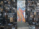 """<h5>Thanks Benoît Maubrey</h5><p>Speakers Wall. Original Berlin Wall section with 1000 loudspeakers, amplifiers, telephone answering machine and radios © by <a href=""""http://www.benoitmaubrey.com/?p=820"""" target=""""_blank"""">Benoît Maubrey</a>. </p>"""