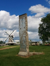 """<h5>Thanks Mennonite Heritage Village</h5><p>© Piece of the Berlin Wall, located at <a href=""""http://www.mennoniteheritagevillage.com/"""" target=""""_blank"""">Mennonite Heritage Village in Steinbach, Manitoba Canada</a></p>"""