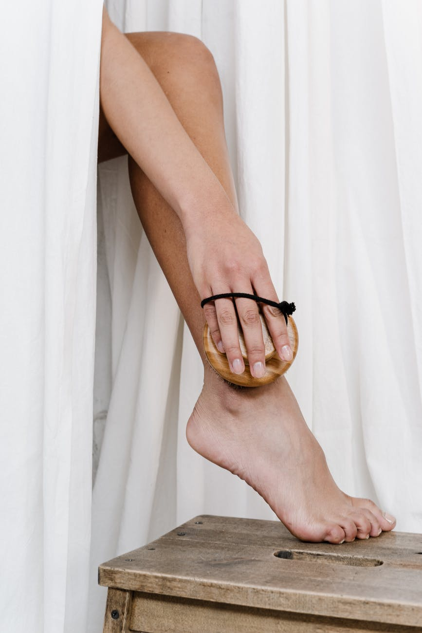 person wearing scrubbing her leg