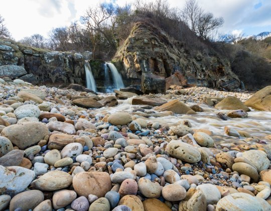 Explore The Hidden Gem With A Waterfall That Flows Onto the Beach This Summer