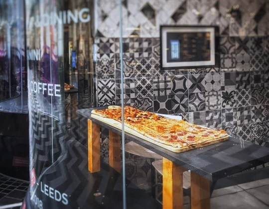 This Leeds Restaurant Is Famous For Its Massive Metre-Long Pizza