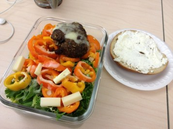 Salad, burger, cheese, and some more bagel