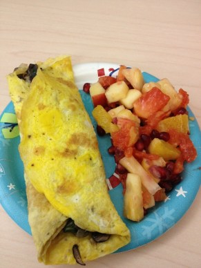 Omlete with fruit salad