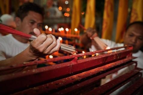 Phuket Vegetarian Festival - lighting incense.
