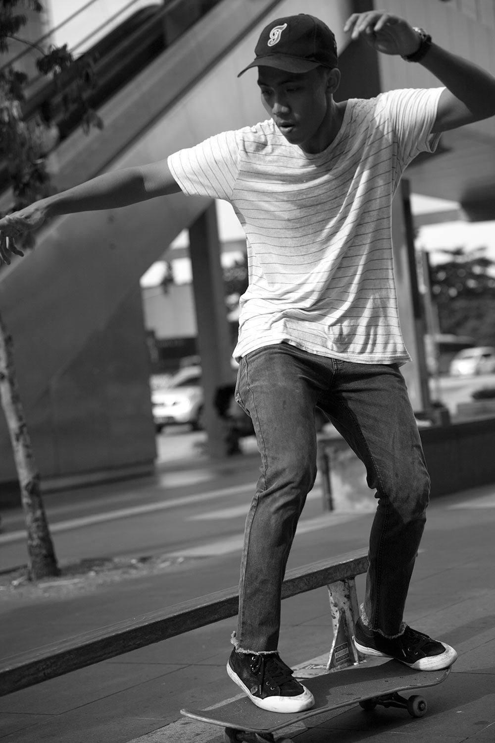 Eric skateboarding KLCC