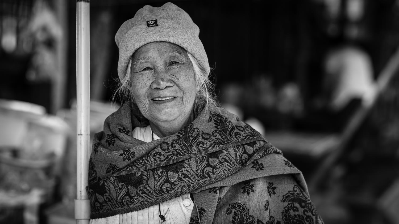 luang prabang elder woman street portrait