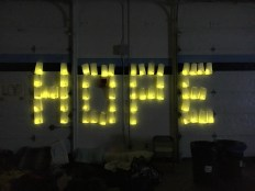 "The word ""Hope"" is illuminated during the events Luminaria Ceremony."