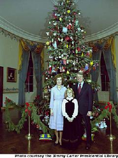 President and Mrs. Carter with daughter Amy in front of The White House Christmas Tree in 1977