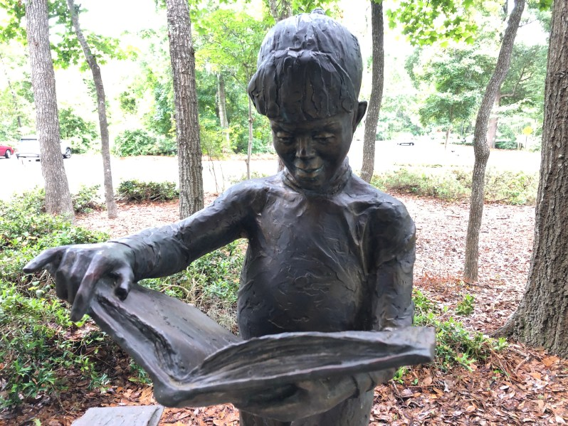 Child reading sculpture