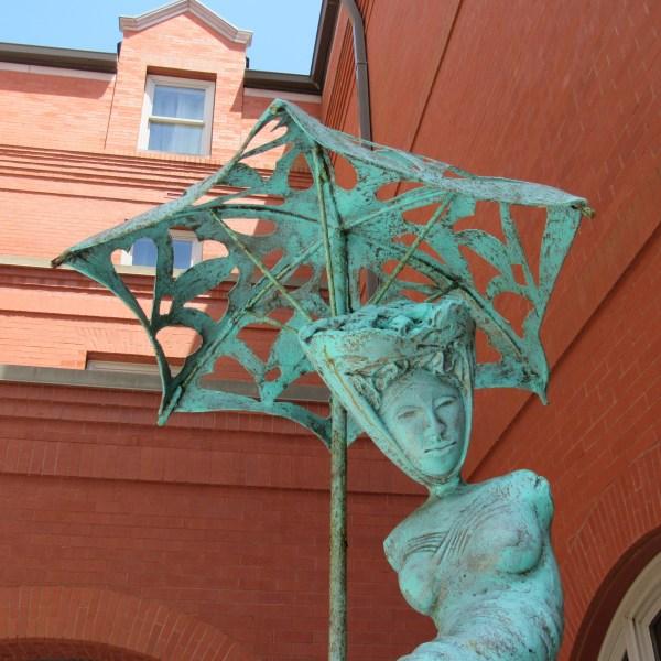 Parasol lady sculpture
