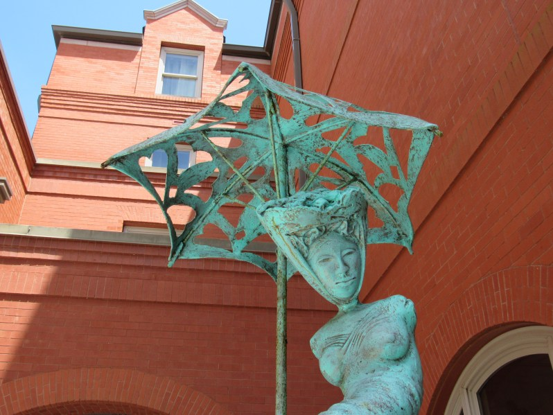 Parasol lady sculpture