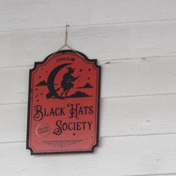 Black Hats Society sign