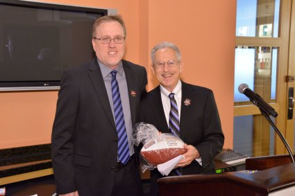 FWAA President Chris Dufresne presented Art Spander a customized football for his historic achievement. (Photo courtesy of Rose Bowl)