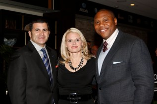 Matt Sign of the National Football Foundation with his wife, Allison, and Ed Stewart, Big 12 associate commissioner for football. (Melissa Macatee photo)