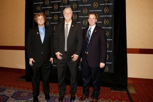 Hall of Famer Pat McInally (center), with his son Jack (left) and John Sudsbury of the Allstate Sugar Bowl at the Eddie Robinson Coach of the Year reception. Photo by Melissa Macatee.