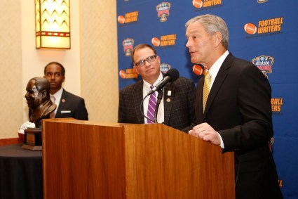 Iowa Coach Kirk Ferentz speaks as Eddie Robinson III (left) and 2015 FWAA President Lee Barfknecht watch on Jan. 9 in Scottsdale, Ariz. Photo by Melissa Macatee.