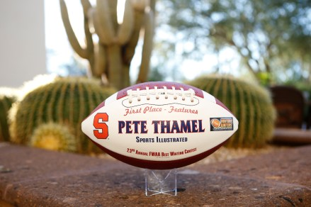 Pete Thamel of Sports Illustrated received this commemorative football in recognition of his first-place in the features category of the FWAA's 2015 Best Writing Contest. Photo by Melissa Macatee.