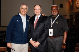 Bob Gennarelli, associate commissioner of the Mid-American Conference, Charlie Fiss, winner of the 2017 Bert McGrane Award, and Alfred White of the College Football Playoff staff at the FWAA's Awards Breakfast on Jan. 9, 2017, in Tampa. Photo by Melissa Macatee.