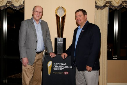 College Football Playoff Executive Director Bill Hancock and Joey Johnston of FWAA All-America Selection Committee with the national championship trophy at the FWAA's Past Presidents Dinner on Jan. 6, 2017, in Tampa. Photo by Melissa Macatee.