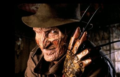 Promotional Freddy Krueger still - Freddy poses with his glove