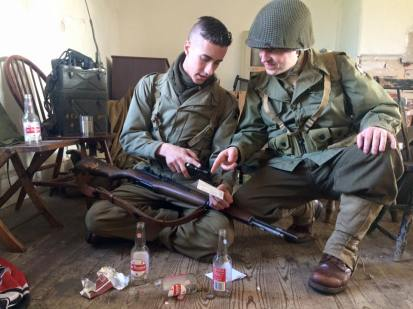 Two soldiers share sodas and look over their favorite pieces of mail. Credit: Melanie Krahling.