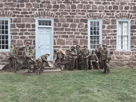 Soldiers relax near an old building in the French countryside. Credit: Grace Nastis.