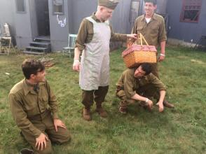 Soldiers amuse themselves by reenacting the Wizard of Oz for curious onlookers. Credit: Melanie Krahling.
