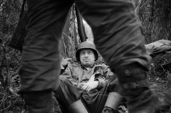 Relaxing in his foxhole, Denton converses with another fellow soldier. Credit: Brian Schade / Jesse Campana.