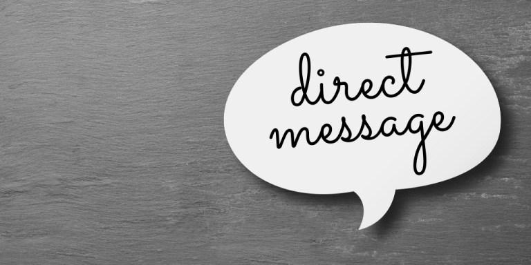 Direct message written on a paper cutout speech bubble