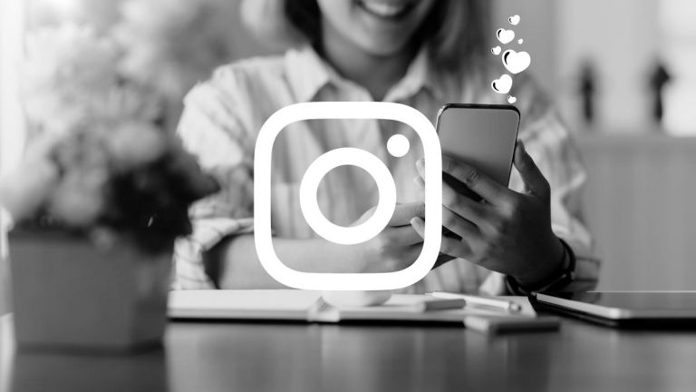 Instagram icon overlaying photo of woman holding phone