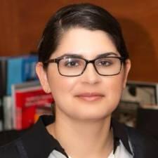 Headshot of Erika Romero of Ever Educating wearing glasses and smiling
