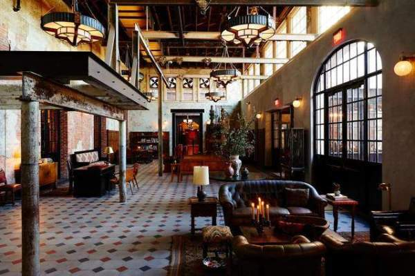 From its mash-up mission-style and Second Empire exterior, Hotel Emma makes a towering statement. Through a colonnade of industrial beams and a set of leaded-glass double doors lies the lobby. #hotelemma #hoteldesign #southwesternhotels