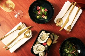From top: tuna tartare, fresh oysters and beef tartare at The Henry Austin