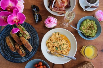 Lobster scrambled eggs, poached eggs, smashed avo, bacon, tomatoes and toast
