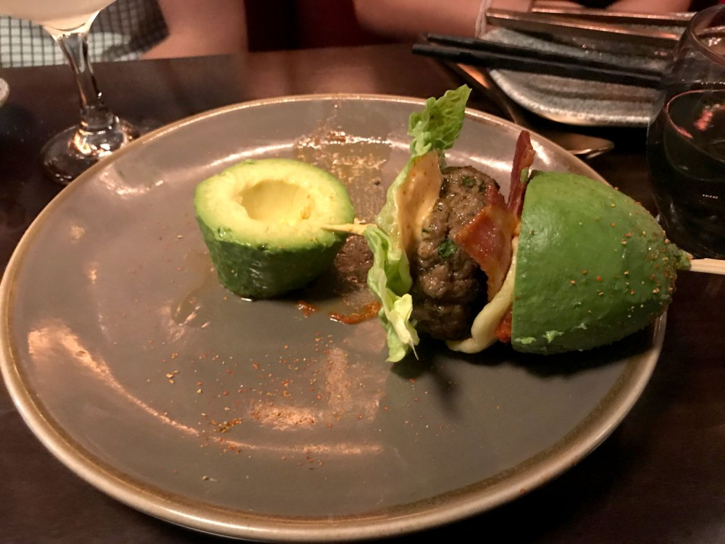 Dissecting the wagyu beef and foie gras avocado burger. MBER restaurant in London.