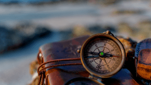 leather bound ournal and compass with green jewel