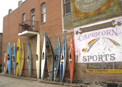 wall of kayaks