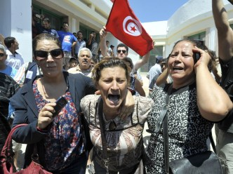 Tunisians react outside a hospital after the killing of the opposition politician Mohamed Brahmi on July 25, 2013 in Ariana,
